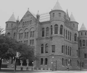 When Louis and Rudy were photographed by Lewis Hine, they were apparently standing next to the Dallas County Courthouse, according to several Dallas historians I have talked to. The masonry work is very similar.