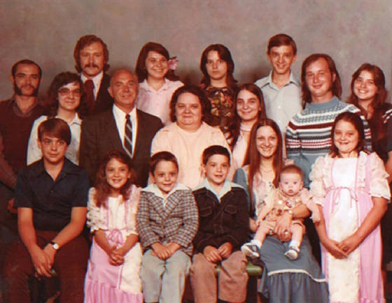 Dorothy (middle of 2nd row), husband John, and their family.