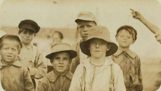 Joseph Alves (front, 2nd from left), 8 yrs old, Biloxi, Miss., February 1911. Photo by Lewis Hine.