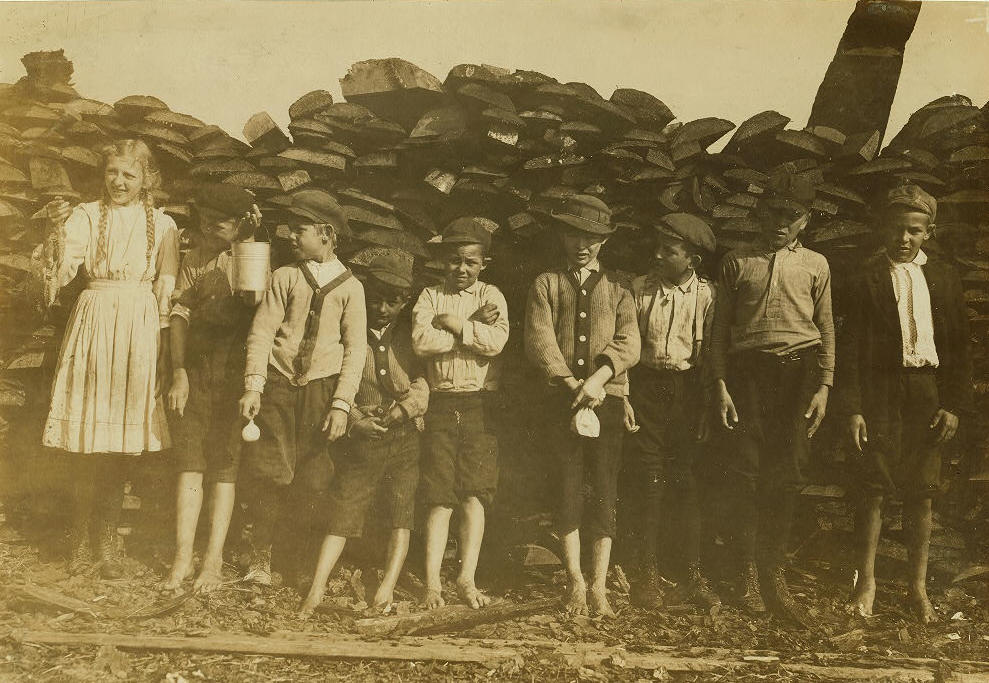 Lazaro Boney (far right), 12 years old, Biloxi, MS, Feb 1911. Photo by Lewis Hine.