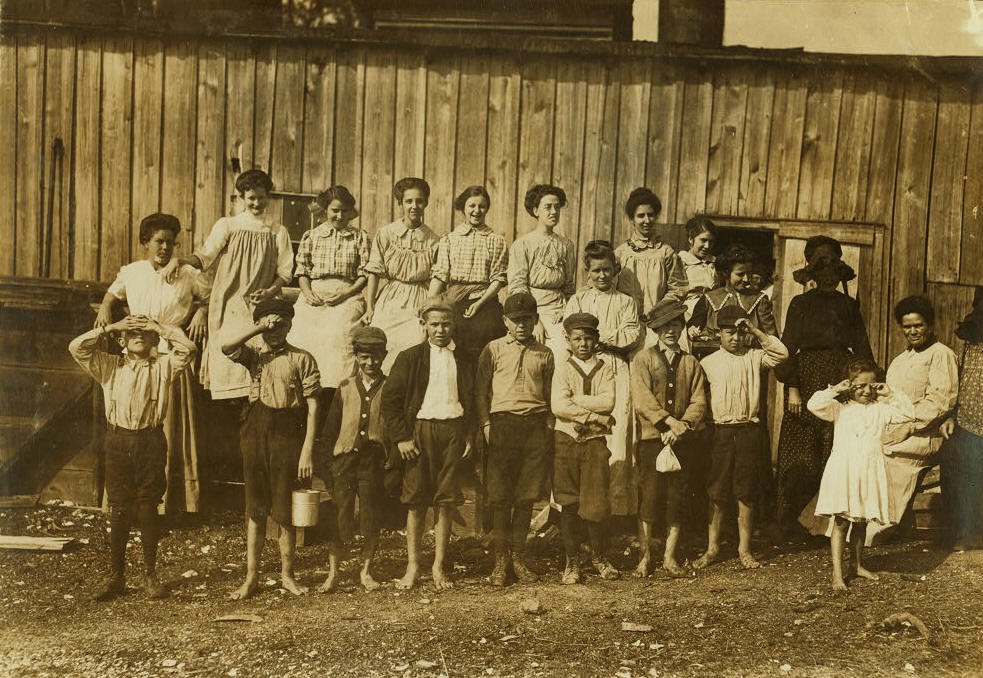 Lazaro Boney, front row, 4th from left, February 1911, Biloxi, Mississippi. Photo by Lewis Hine.