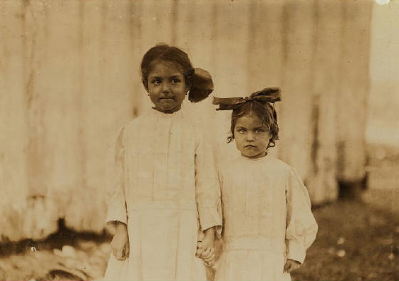 Mildred (right), 3 yrs old & Gertrude Kron, 5 yrs old, Biloxi, MS, Feb. 1911. Photo by Lewis Hine.