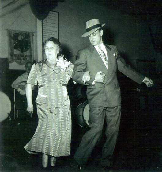 "Pearl Capps and her son Earl doing the ""cake walk"" at her 50th wedding anniversary, 1952."