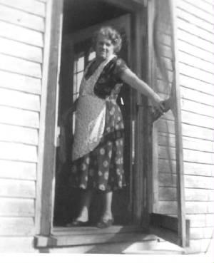 Rose Berdych DeChriste, wearing her apron, 1954.